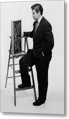 A Portrait Of Paul Mccobb Leaning On A Ladder Metal Print by Herbert Matter