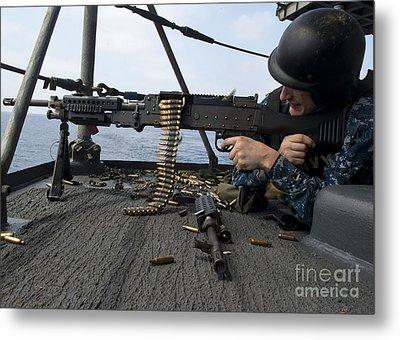 A Sailor Fires An M-240b Machine Gun Metal Print by Stocktrek Images