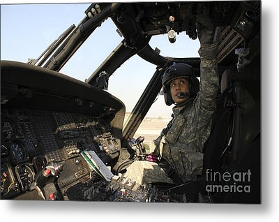 A Uh-60 Black Hawk Helicopter Metal Print by Stocktrek Images