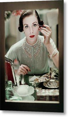 A Woman Applying Make-up Metal Print by Frances Mclaughlin-Gill