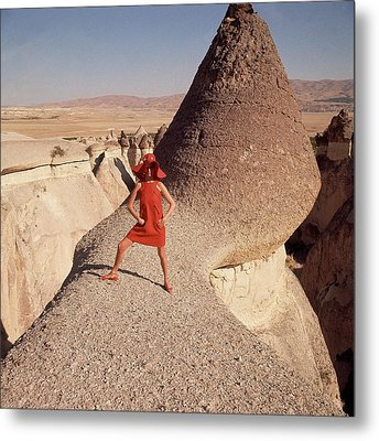 A Woman Modeling A Red Dress In Goreme Metal Print by Henry Clarke