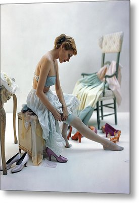 A Woman Putting On Her Stockings Metal Print