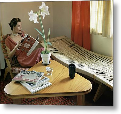 A Woman Sitting By A Coffee Table And Chaise Metal Print