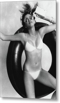 A Young Woman Floating On An Inner Tube Metal Print by Albert Watson