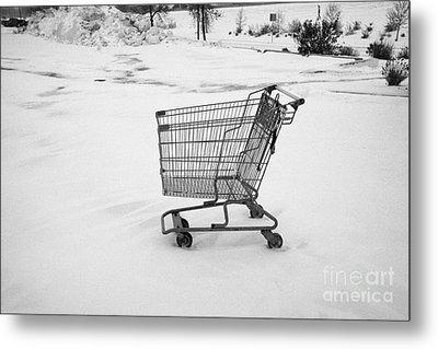 abandoned shopping cart in snow covered supermarket parking lot Saskatoon Saskatchewan Canada Metal Print