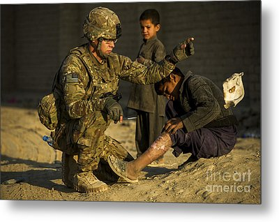 Airman Provides Medical Aid To A Local Metal Print by Stocktrek Images