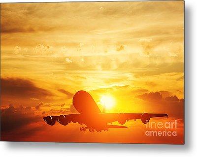 Airplane Taking Off At Sunset Metal Print