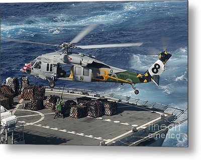 An Mh-60s Sea Hawk Helicopter Picks Metal Print by Stocktrek Images