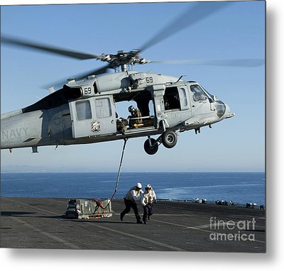 An Mh-60s Sea Hawk Helicopter Prepares Metal Print by Stocktrek Images