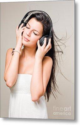 Brunette Immersed In Music Wearing Headphones. Metal Print by Alstair Thane