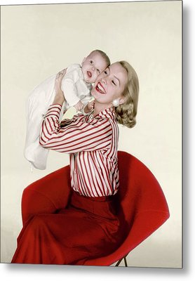 Dina Merrill Holding A Baby Metal Print