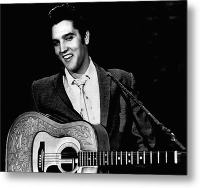 Elvis Presley Smiles While Holding Guitar Metal Print by Retro Images Archive