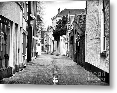 Empty Street In Bruges Metal Print by John Rizzuto