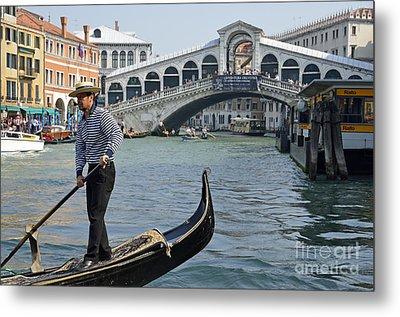 Gondolier On Gondola By Rialto Bridge Metal Print by Sami Sarkis
