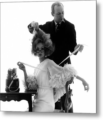 Hairstylist Kenneth Holding The Hair Of A Model Metal Print by Bert Stern