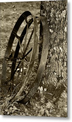 Metal Print featuring the photograph Iron Wheel by Linda Segerson
