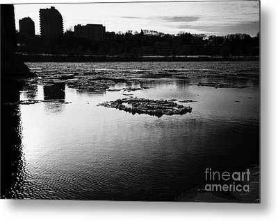 large chunks of floating ice on the south saskatchewan river in winter flowing through downtown Sask Metal Print