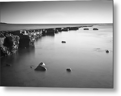 Long Exposure Image Of Tide Going Out Over Rock Ledge During Sun Metal Print by Matthew Gibson