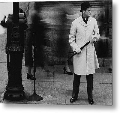 Man Wearing A Raincoat Metal Print by John Rawlings