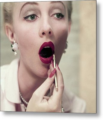Model Applying Revlon Lipstick Metal Print