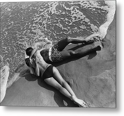 Models Embracing On A Beach Metal Print by Mark Patiky