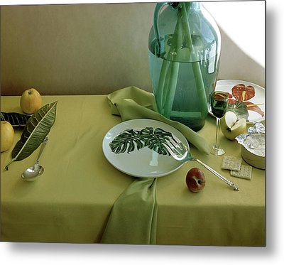 Plates, Apples And A Vase On A Green Tablecloth Metal Print by Horst P. Horst