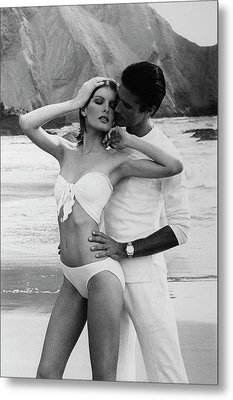 Rene Russo Posing With A Male Model On A Beach Metal Print by Francesco Scavullo