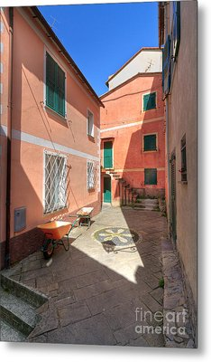 small square in Camogli Metal Print by Antonio Scarpi