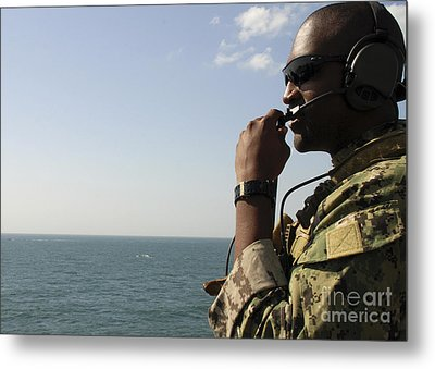 Soldier Instructs Small Boat Maneuvers Metal Print by Stocktrek Images