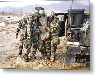 Soldiers Conduct Medical Evacuation Metal Print by Stocktrek Images