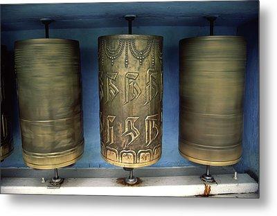 Spinning Prayer Wheels Is Said To Send Metal Print by Paul Dymond