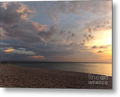 Sunset Grand Cayman Metal Print by Peggy Hughes