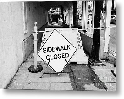 temporary sidewalk closed signs at construction site in downtown Vancouver BC Canada Metal Print by Joe Fox