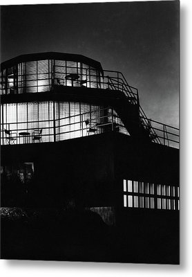 The Exterior Of A Spiral House Design At Night Metal Print by Eugene Hutchinson