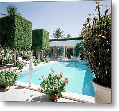 The Pool And Garden Of A Home Metal Print by William Grigsby
