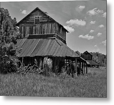 Tobacco Barns With Clouds Metal Print by Sandra Anderson