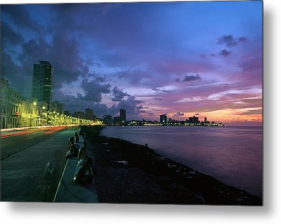 Twilight View Of Young Cubans Sitting Metal Print by Steve Winter