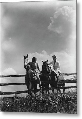 Two Women Sitting On A Fence With Horses Metal Print by Lusha Nelson