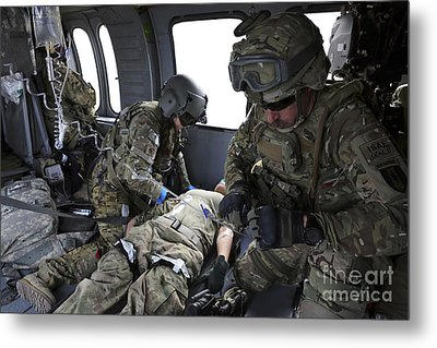 U.s. Army Flight Medics Aid A Simulated Metal Print by Stocktrek Images