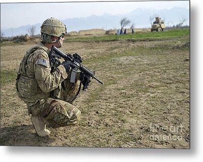 U.s. Soldier Patrols A Village Metal Print by Stocktrek Images