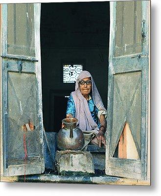 Varanasi Water Seller Metal Print by Shaun Higson