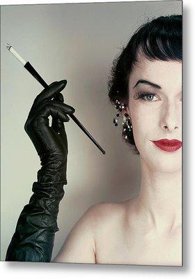 Victoria Von Hagen Holding A Cigarette Holder Metal Print by Erwin Blumenfeld