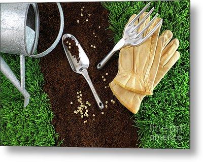 Assortment Of Garden Tools On Earth Metal Print by Sandra Cunningham