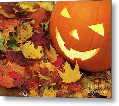 Carved Pumpkin On Fallen Leaves Metal Print by Oleksiy Maksymenko