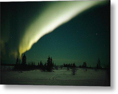 The Aurora Borealis Glows Brightly Metal Print by Norbert Rosing