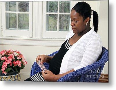 Pregnant Woman Taking Vitamins Metal Print by Photo Researchers