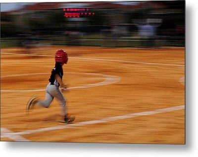 A Boy Runs During A Baseball Game Metal Print by Raul Touzon