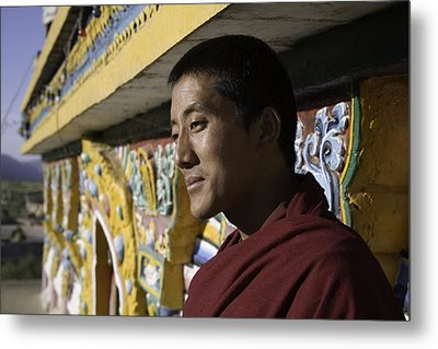 A Buddhist Monk Near The Edge Metal Print by David Evans