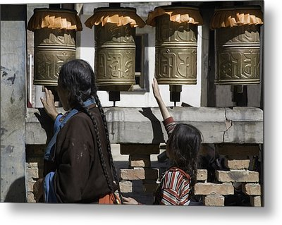 A Buddhist Woman And Child Spin Brass Metal Print by David Evans