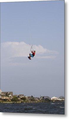 A Kiteboarder Jumps High Over Beach Metal Print